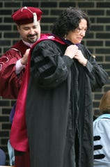 Associate Justice Sonia Sotomayor, left, the first Hispanic Supreme Court Justice, with College president Peter P. Mercer, right, was given an honorary degree at the 53rd  Ramapo College of NJ Commencement in Mahwah, May 2011.