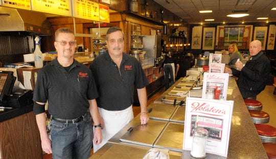 Holsten's owners Ronald Stark left, and Christopher Carly stand behind the counter of their ice cream parlor.