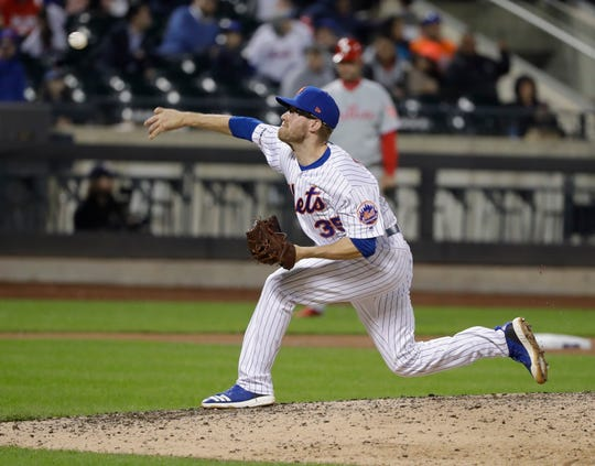 New York Mets' Jacob Rhame (35) delivers a pitch during the ninth inning of a baseball game against the Philadelphia Phillies Tuesday, April 23, 2019, in New York. The Mets won 9-0.