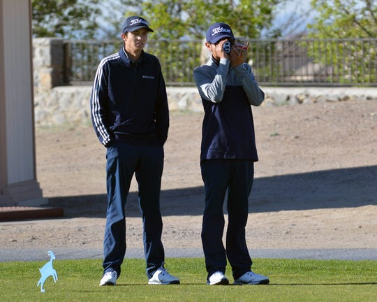 Jaime Guzman for the Sun-News  Chip Rogers (left) and Nemo Perales (right) check out the distance to the flag at this year's Dona Ana Invitational Golf Tournament held April 1 at Sonama Ranch Golf Course in Las Cruces.