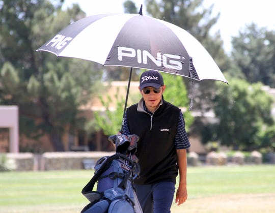 Deming High golf teams hosted the Deming Invitational Tournament Thursday at the Rio Mimbres Golf Course in Deming. A field of 115 golfers representing 14 schools competed in the 18-hole event.  Senior Wildcat Nemo Perales strolls under his umbrella to the 9th hole under a bright sunny sky.  Sophomore Lady 'Cat Kamryn Zachek took her approach to the No. 18 green from behind an old cottonwood tree.  Senior Wildcat Chip Rogers had a steady short game going through the first nine holes of the Deming Invitational Tournament.