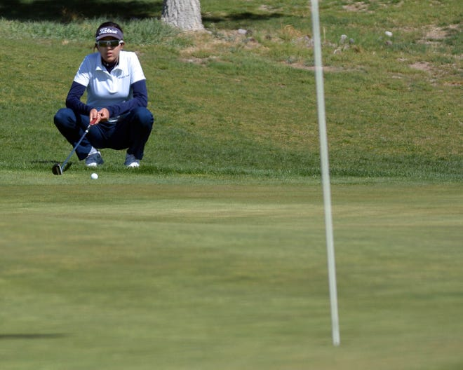 Jaime Guzman for the Sun-News  Mona Magana sizes up her putt attempt before she takes her turn at this year's Dona Ana Golf Invitational held in April 1 at Sonoma Ranch Golf Course in Las Cruces.