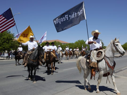 Cowboys for Trump leader Couy Griffin, also an Otero County Commissioner, leads a procession of horseback riders into a parking lot across from the Doña Ana County Government Center on Thursday, April 25, 2019 in Las Cruces. Participants held a rally in support of conservative issues.