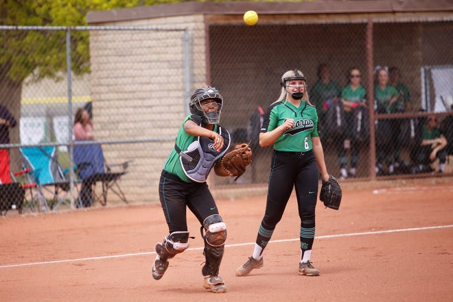 Farmington's Ulysse Morales attempts to get a quick out at first base against West Mesa on Saturday, April 20 at Ricketts Softball Complex.