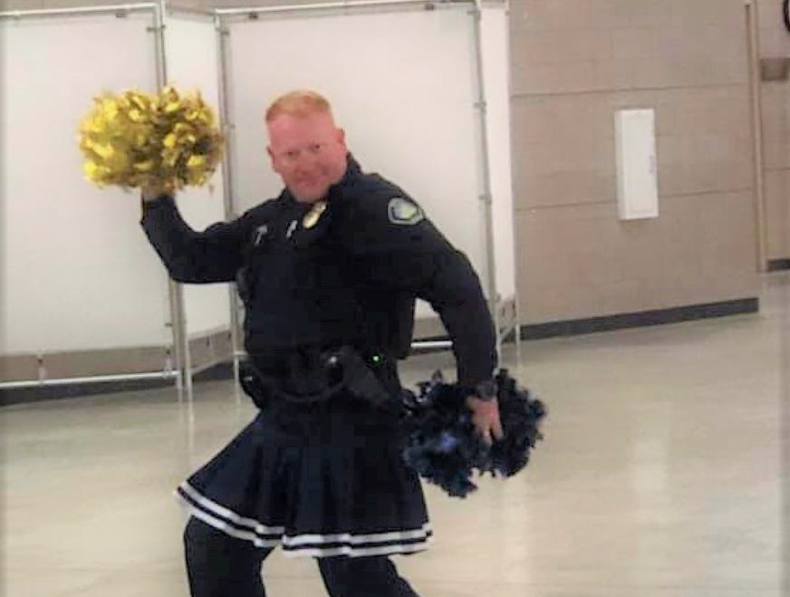 Police Chief Hooker and cheer team squad leader shows off his cheer skills at the Ruidoso Middle School pep assembly. Who knew he is a man with so many hidden talents?