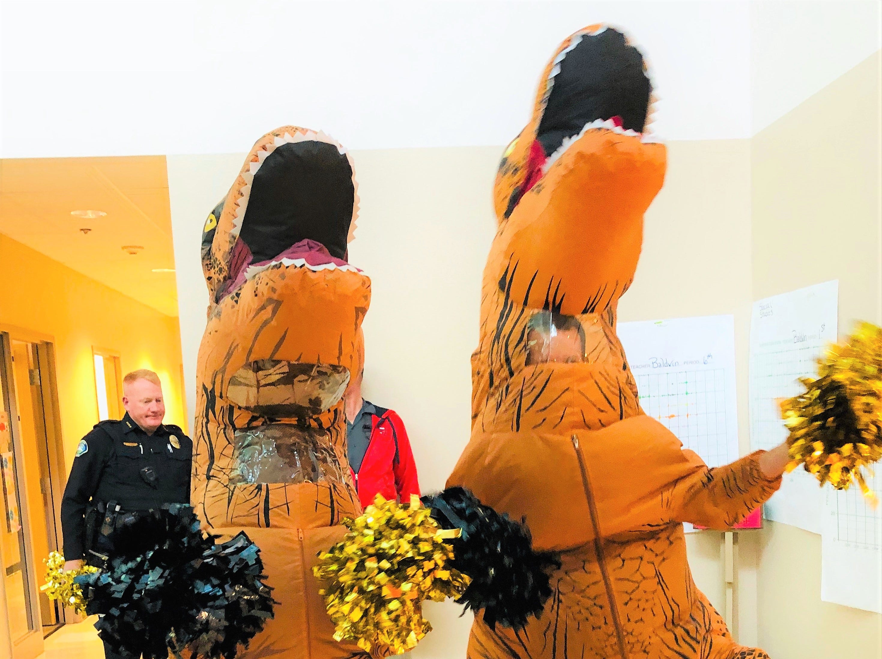 Team T-Rex practices cheers as the prepare for the pep assembly at Ruidoso Middle as the student body gears up for two weeks of testing.