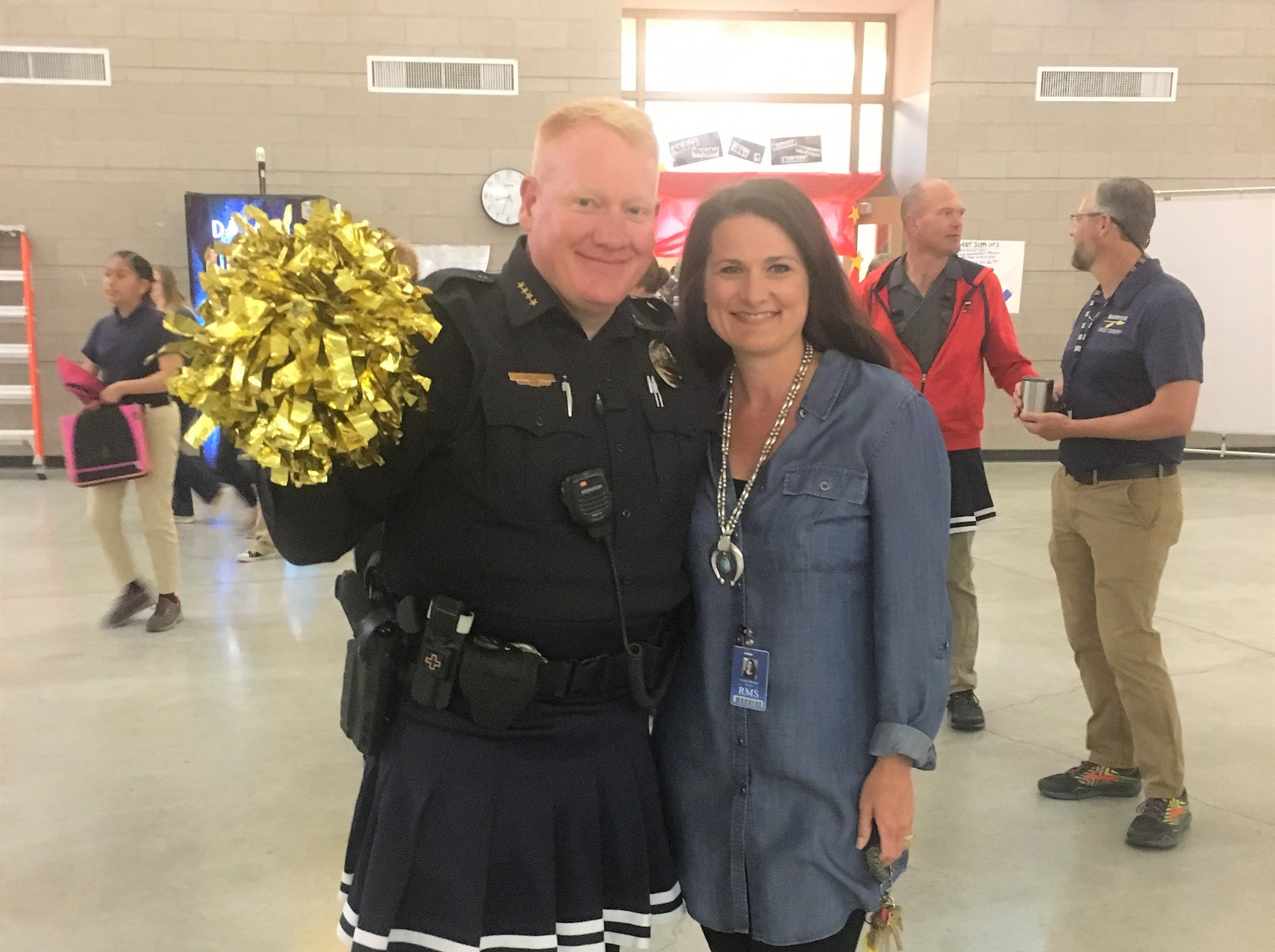 Chief Hooker and RMS principal Cecily Hooker take time out to pose at the Ruidoso Middle School pep assembly.