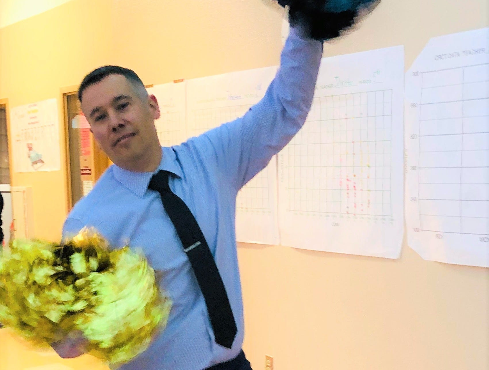 """""""Go-Team- Ruidoso-Go"""" as assistant superintendent Jason Edmister performers his cheer rendition to the Warrior fight song."""