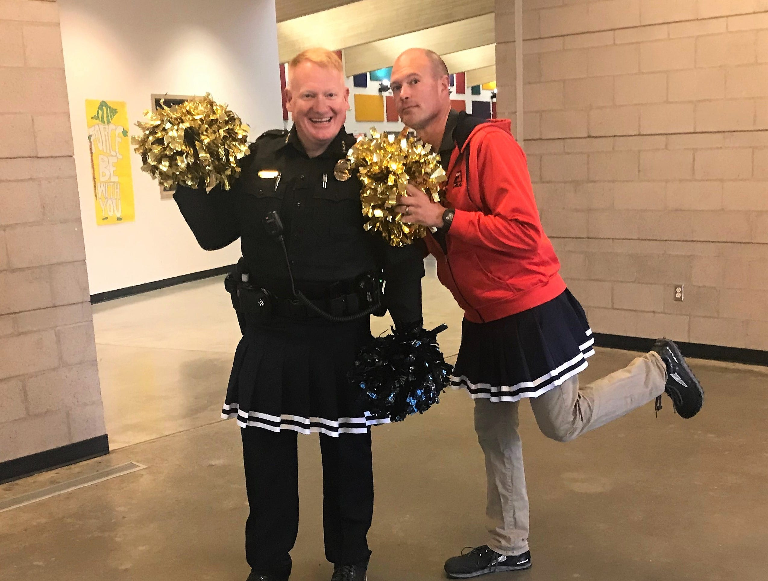 Ruidoso Police Chief Darren Hooker and school board president Luther Light get their pom-poms ready to cheer on the student body at RMS prior to PARCC testing.