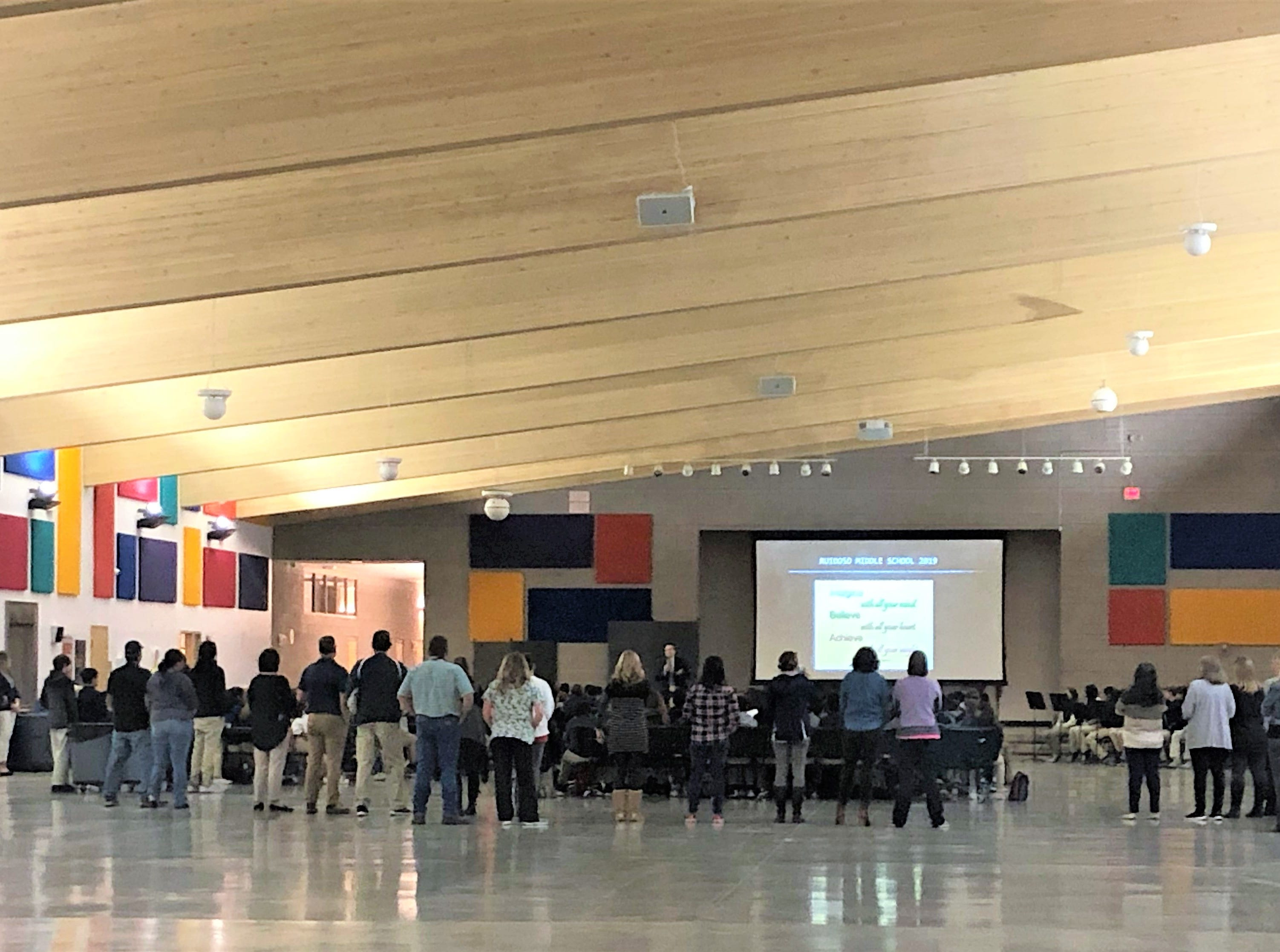 Dr. Bickert speaks to staff, parents and students at an assemble  to encourage the students to do their best during the next two weeks of testing.