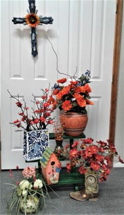Real and not-so-real flower arrangements will be sold along with other decorative items.