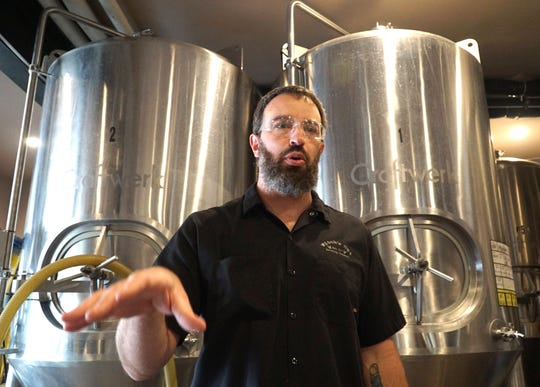 Ryan Cottongim, owner of South Lyon's Witch's Hat Brewing Company, talks about the process of making some of their beers and ales in their Lafayette Street brewery in this file photo.
