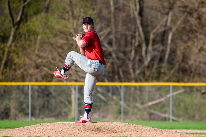 John Glenn pitcher Chad Stevens winds up to deliver a pitch in a game against Wayne Memorial on Monday.