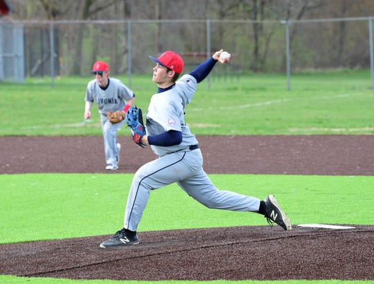 Franklin's Alex Forry delivers a pitch against Churchill on April 24, 2019.