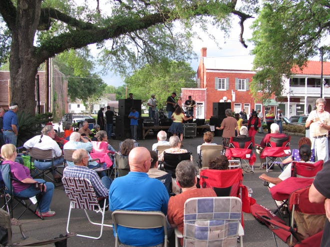 Crowds gather to listen and dance to the music at the Music & Market outdoor concert. The free concert series kicks off its five-week spring season Friday with JC Melancon & the Bayou Rock Band at the Farmers Market Pavilion in Opelousas.