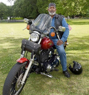 Anthony Standberry sits aboard his motorcycle that he will ride Saturday during the 14th annual Delores Standberry Education and Scholarship Fund Raiser event that leaves from the Yambilee Building at noon Saturday.