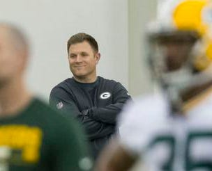 Green Bay Packers general managers Brian Gutekunst smiles as he watches during NFL rookie football camp in Green Bay, Wis., Friday, May 4, 2018. (AP Photo/Mike Roemer) ORG XMIT: WIMR110