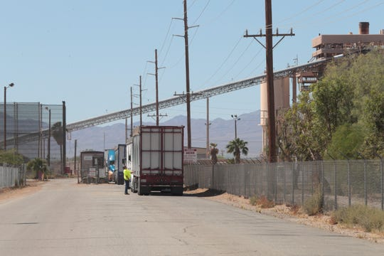 Trucks line up to enter Desert View Power in Mecca, Calif., April 23, 2019. The plant is a biomass electrical generation facility that is permitted to burn both urban and agricultural woodwaste.