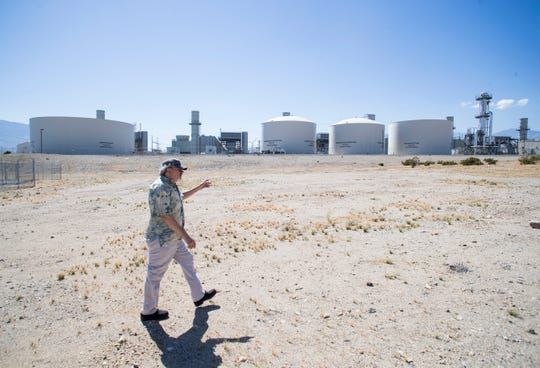 Robert Terry, head of People Over Pollution, and others fought strenuously to keep the Sentinel power plant, pictured behind him, from being opened in unincorporated Palm Springs because of the pollution it would emit. They lost and the plant opened in 2013. He is photographed in April of 2019.