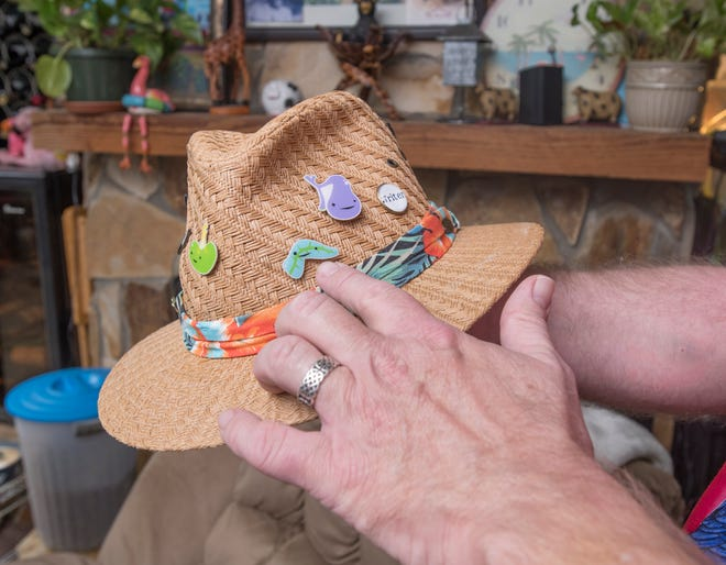 """Doug Janousek jokingly points to his """"replacement pancreas"""" in the form of a hat pin, at his home in Gulf Breeze on Thursday."""