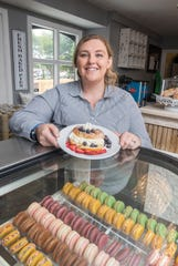 Co-owner Serena Thomas holds a stuffed French toast dish at the new Adonna's Garden St. Cafe & Bakery in Pensacola on Thursday.