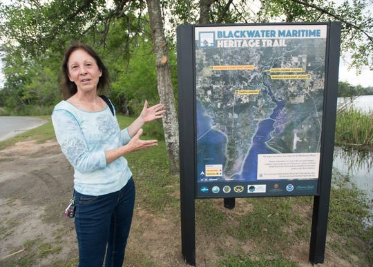 Bagdad Waterfronts Florida Partnership member Lee Ann Winchester talks about the new signage during the ribbon cutting ceremony for the Blackwater Heritage Trail project at the Carpenter's Park Boat Ramp in Milton on Thursday, April 25, 2019.