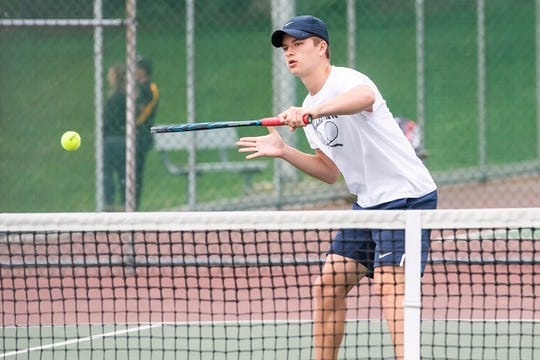 Dallastown's Holden Koons returns the ball to Spring Grove's Dennis Eicholtz during the first round of the YAIAA 3A tennis tournament at South Western High School Thursday, April 25, 2019. Koons earned his fourth league title by defeating York Suburban's Parker Lando 6-0,6-0 in the final on Saturday.