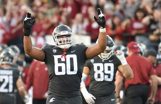 Washington offensive lineman Andre Dillard celebrates a Cougars touchdown during a game against Oregon at Martin Stadium.