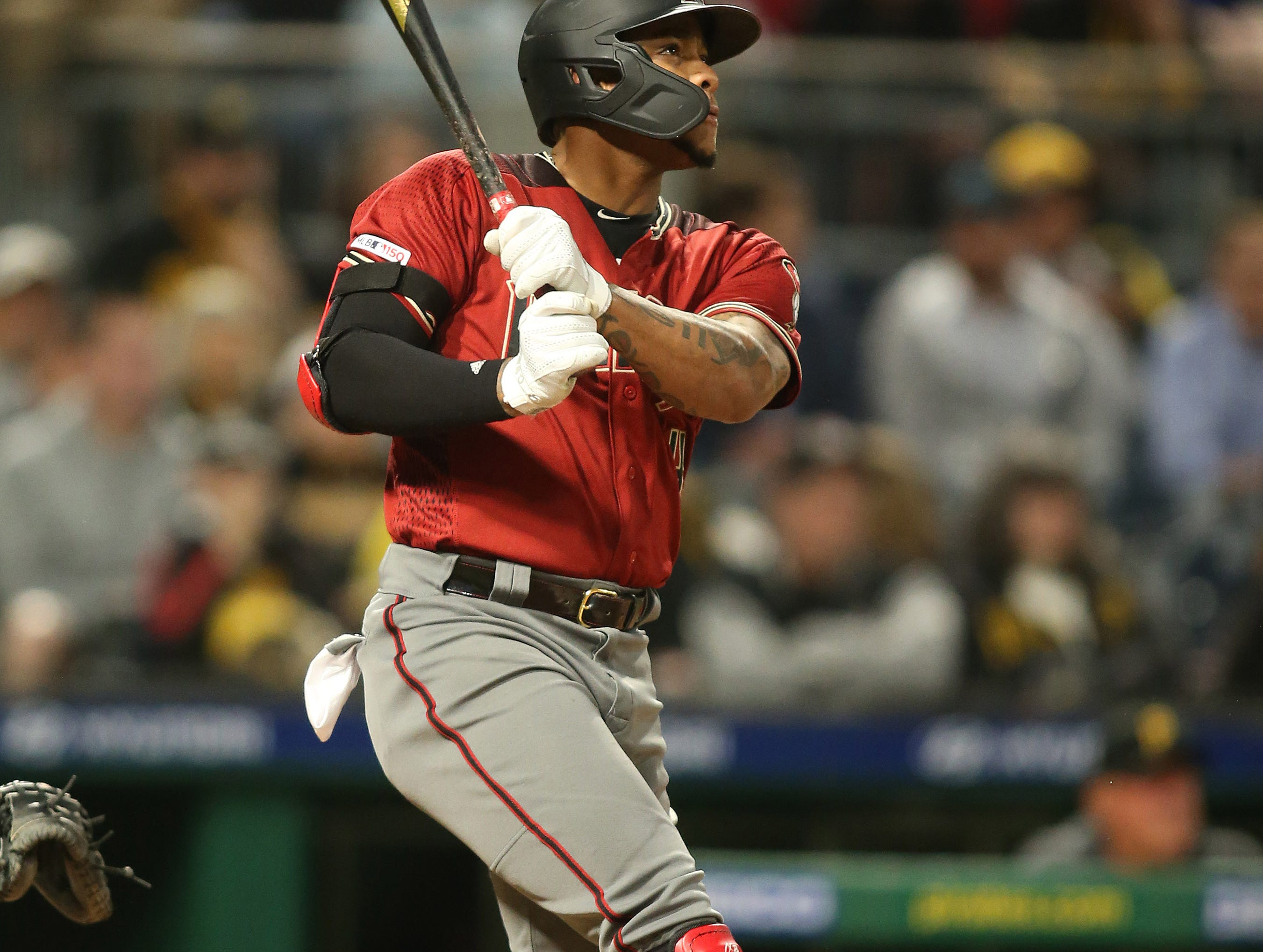 Apr 24, 2019; Pittsburgh, PA, USA;  Arizona Diamondbacks center fielder Ketel Marte (4) hits a solo home run against the Pittsburgh Pirates during the fifth inning at PNC Park. Mandatory Credit: Charles LeClaire-USA TODAY Sports