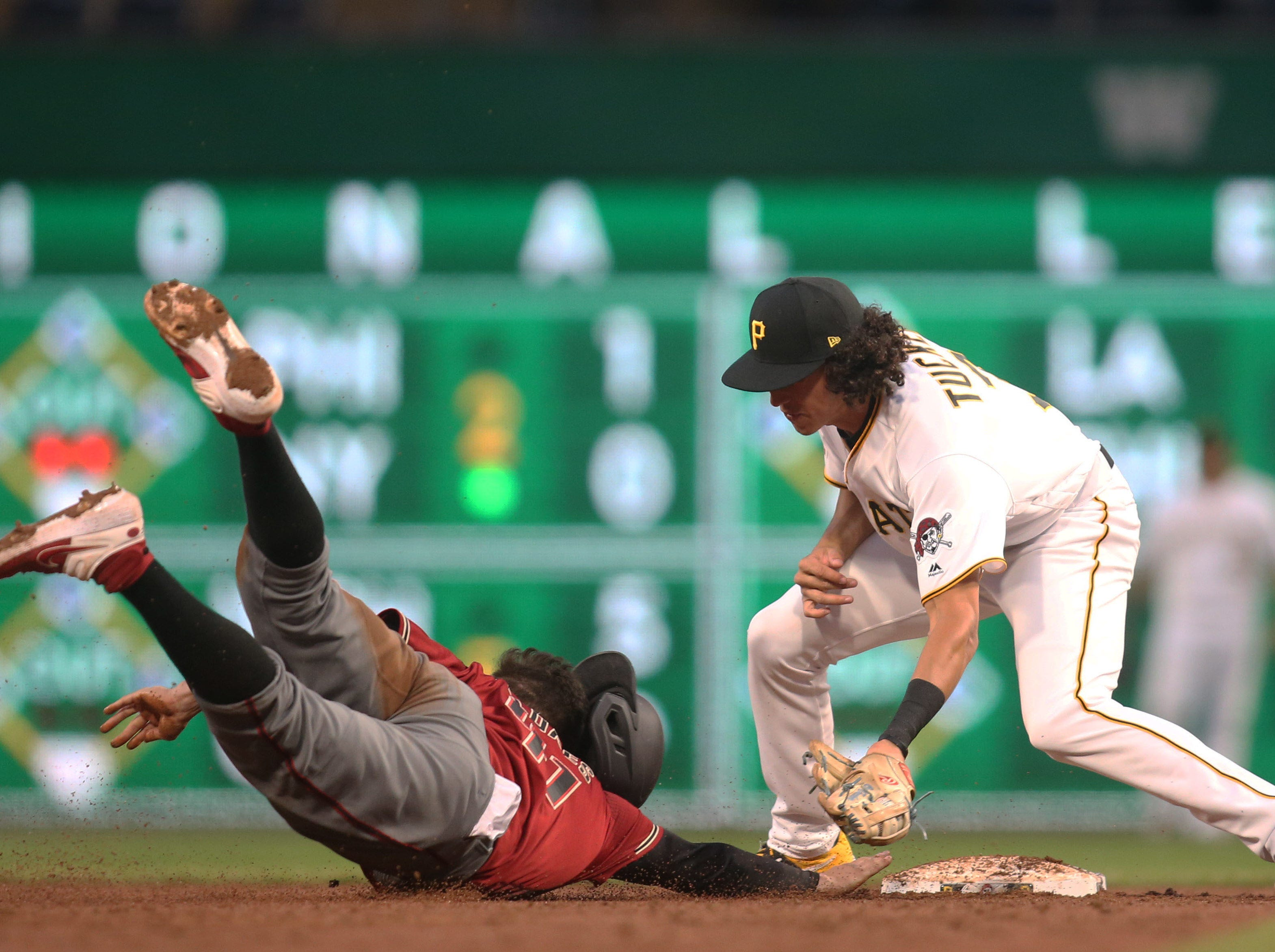 Apr 24, 2019; Pittsburgh, PA, USA;  Arizona Diamondbacks second baseman Wilmer Flores (41) is picked off of second base as Pittsburgh Pirates shortstop Cole Tucker (3) applies the tag during the third inning at PNC Park. Mandatory Credit: Charles LeClaire-USA TODAY Sports