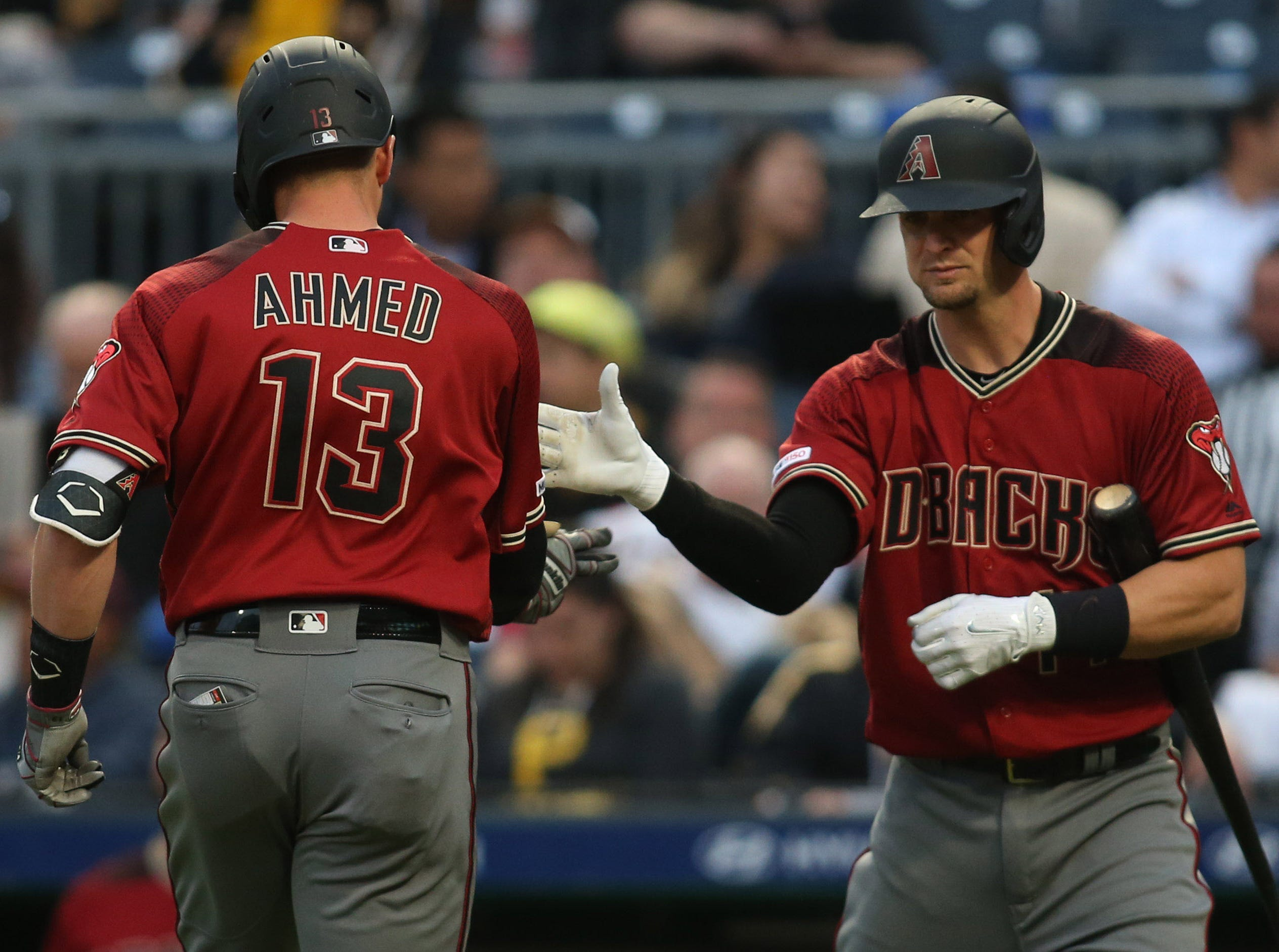 Apr 24, 2019; Pittsburgh, PA, USA;  Arizona Diamondbacks catcher Caleb Joseph (R) congratulates shortstop Nick Ahmed (13) after Ahmed hit a solo home run against the Pittsburgh Pirates during the second inning at PNC Park. Mandatory Credit: Charles LeClaire-USA TODAY Sports