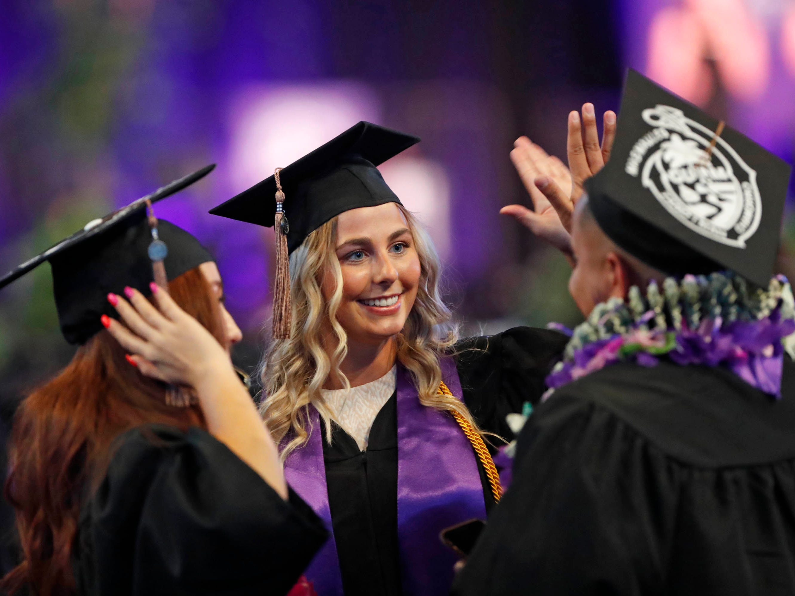 Grand Canyon University graduates celebrate during their commencement ceremony. The university will give out more than 25,000 degrees to the class of 2019, the largest in its history.