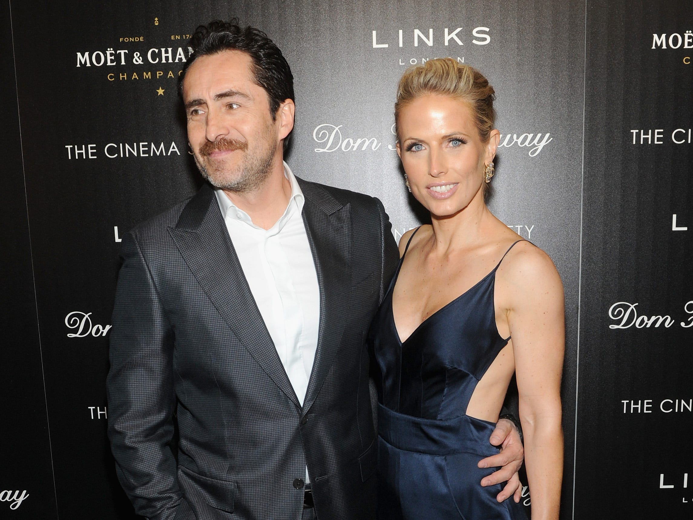 """Demian Bichir and Stefanie Sherk attend a screening of his film """"Dom Hemingway"""" on March 27, 2014, in New York City."""
