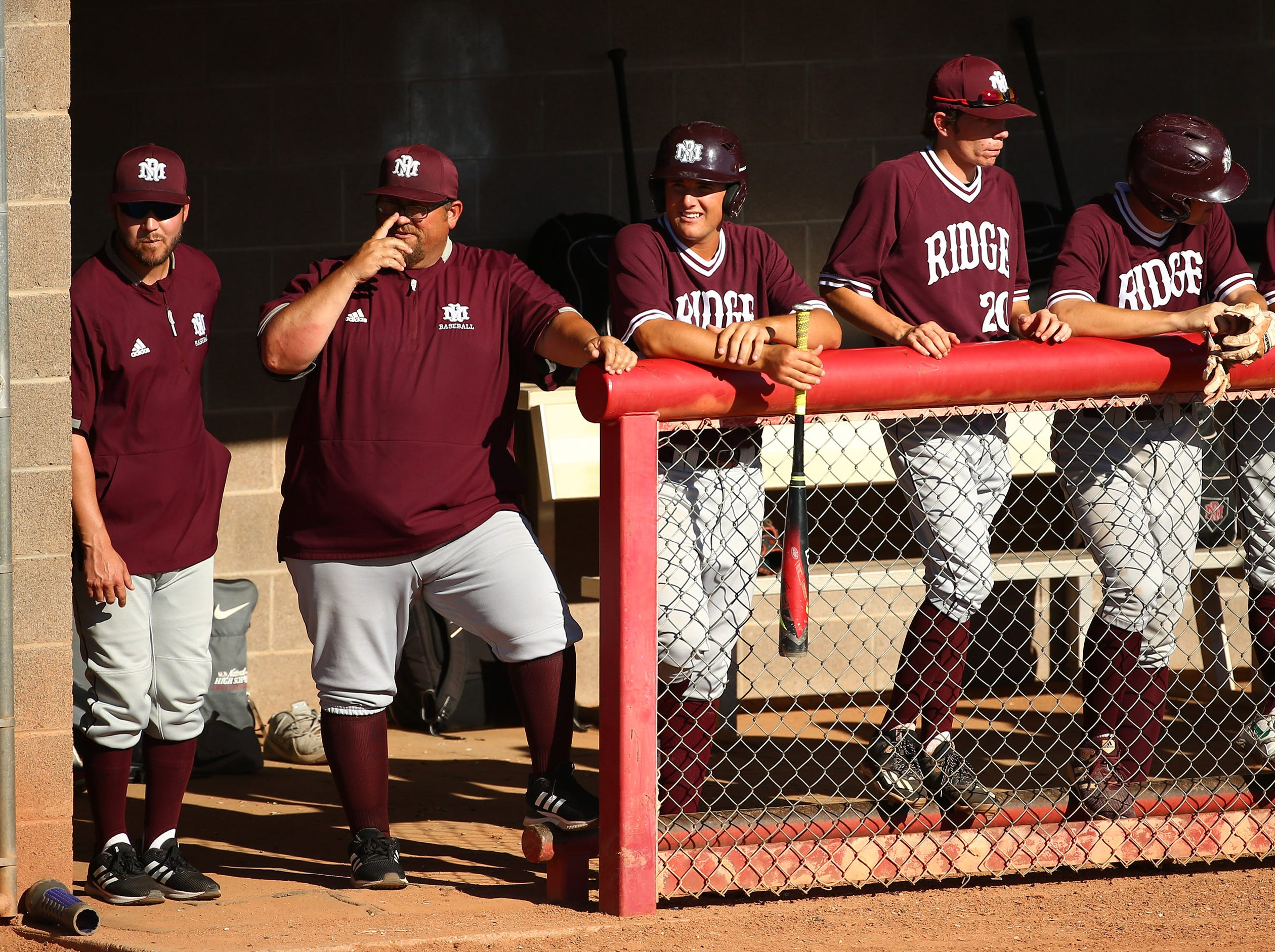 Mountain Ridge coach Artie Cox (second to the left) against Brophy Prep in the third inning on Apr. 24, 2019 in Phoenix, Ariz