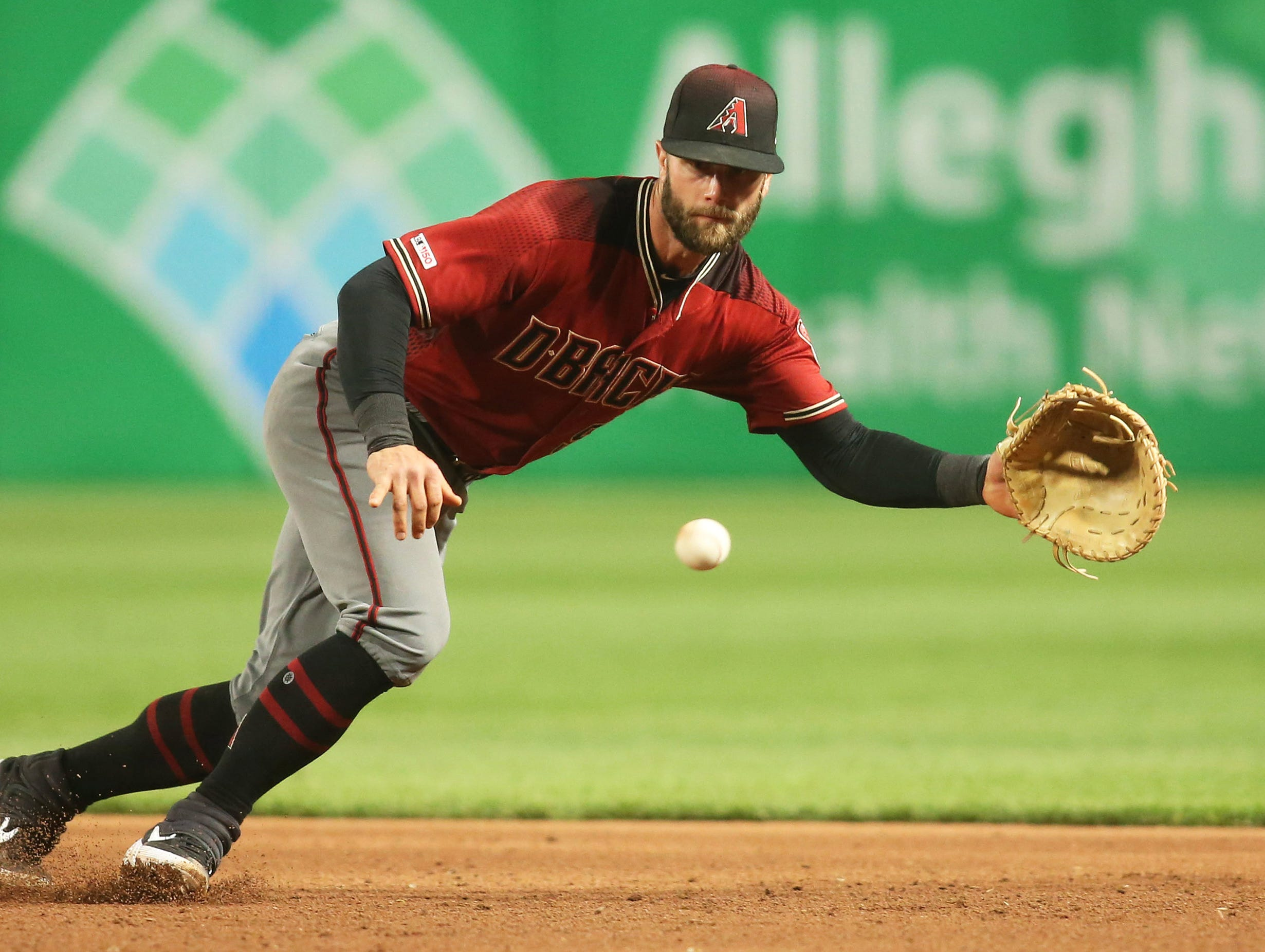 Apr 24, 2019; Pittsburgh, PA, USA;  Arizona Diamondbacks first baseman Christian Walker (53) fields a ground ball against the Pittsburgh Pirates during the ninth inning at PNC Park. Mandatory Credit: Charles LeClaire-USA TODAY Sports
