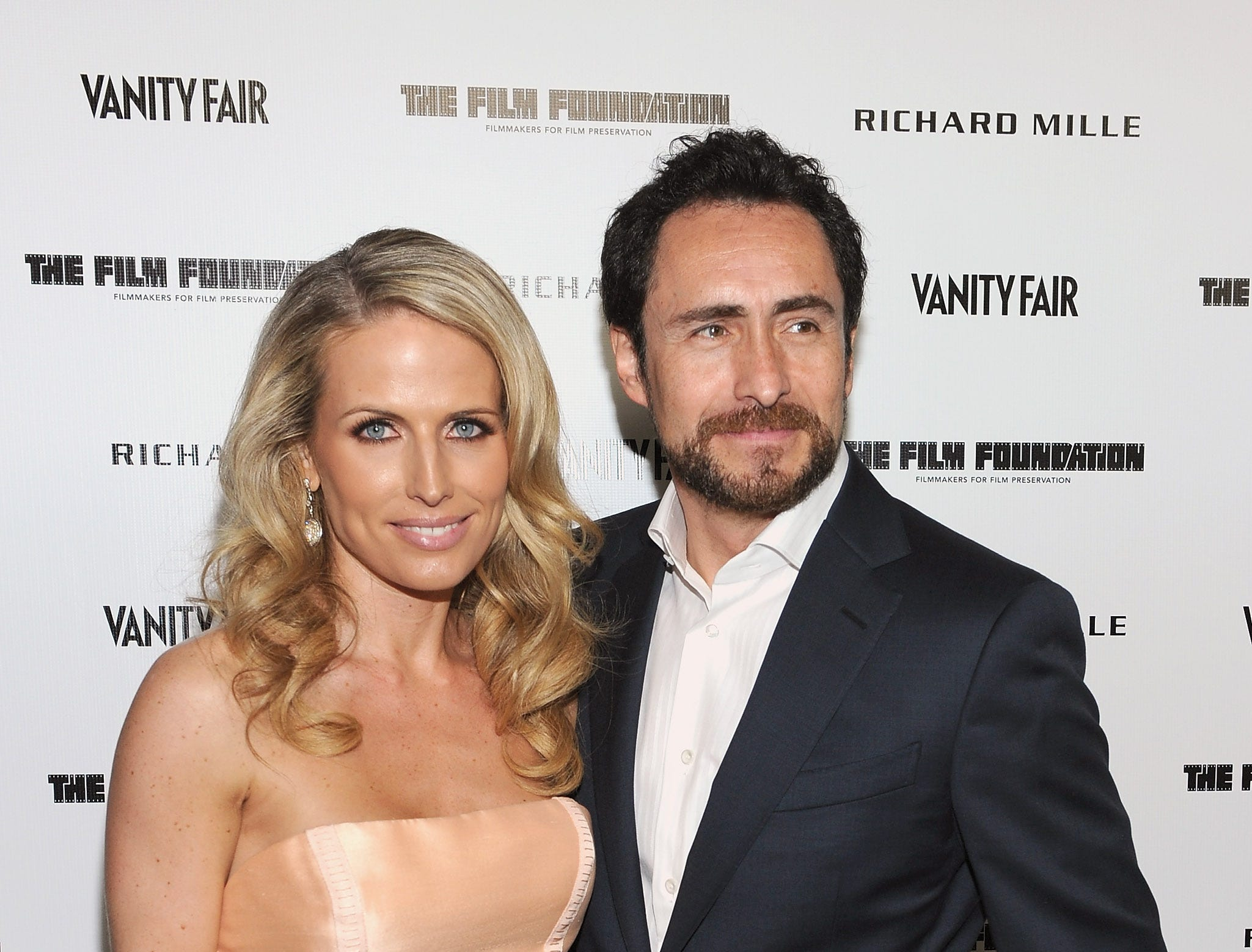 Demian Bichir and Stefanie Sherk attend the Vanity Fair and Richard Mille celebration of Martin Scorsese in support of The Film Foundation at Hotel Bel-Air on February 24, 2012, in Los Angeles.