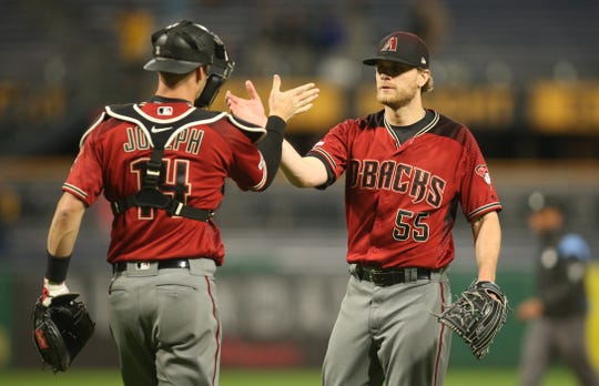 Apr 24, 2019; Pittsburgh, PA, USA;  Arizona Diamondbacks catcher Caleb Joseph (14) and relief pitcher Matt Koch (55) celebrate after defeating the Pittsburgh Pirates at PNC Park. Mandatory Credit: Charles LeClaire-USA TODAY Sports