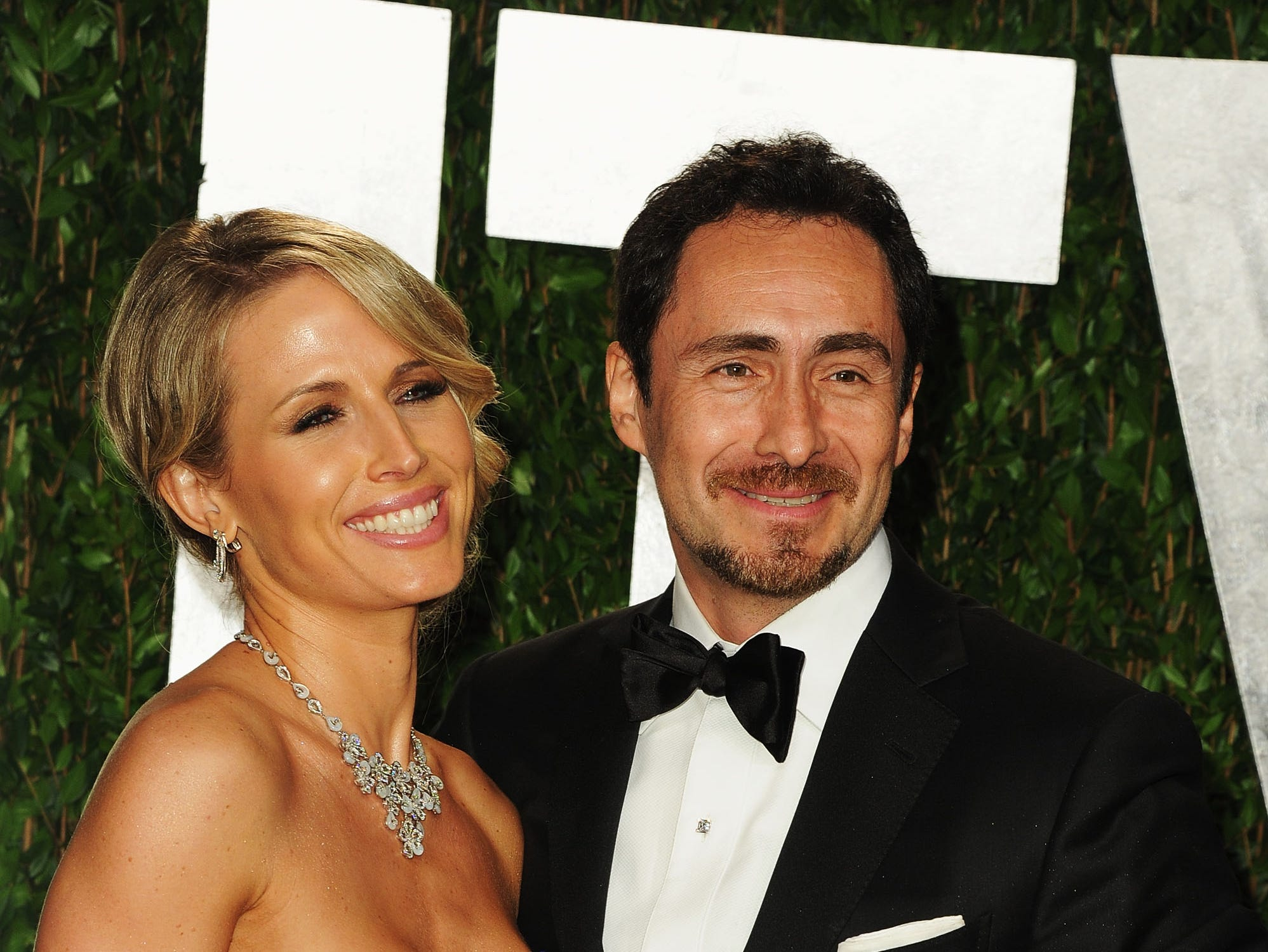 Demian Bichir and Stefanie Sherk arrive at the 2012 Vanity Fair Oscar Party hosted by Graydon Carter at Sunset Tower on February 26, 2012, in West Hollywood, California.