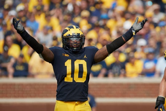 a77778ad5 Michigan linebacker Devin Bush fires up the crowd during a game against Air  Force at Michigan