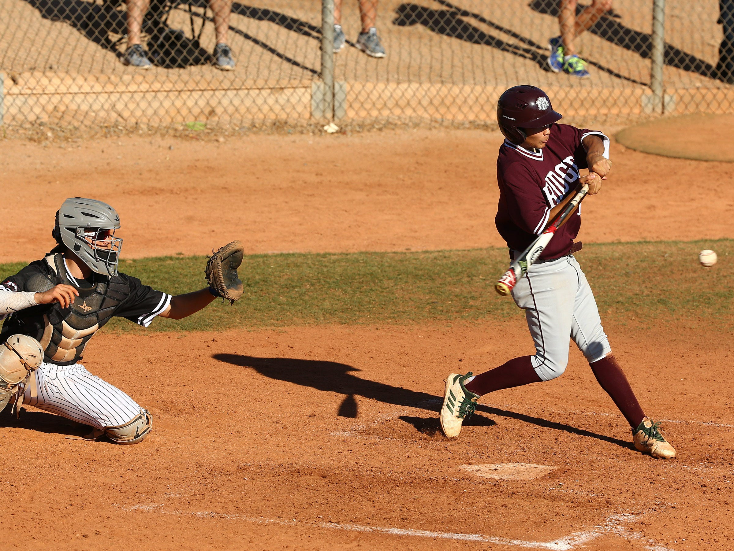 Mountain Ridge High's AJ Singer (17) drives in two runs against Brophy Prep in the third inning on Apr. 24, 2019 in Phoenix, Ariz