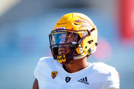 Arizona State receiver N'Keal Harry warms up before a game against Arizona during the Territorial Cup at Arizona Stadium.