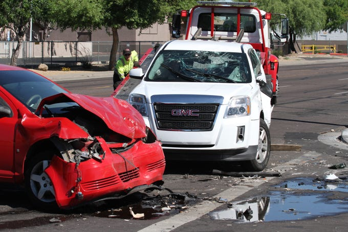 Four people, including a 14-year-old girl, were seriously injured in a four-vehicle collision in Phoenix on April 25, 2019.