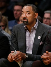 Heat assistant Juwan Howard watches a game from the bench on March 16, 2018.