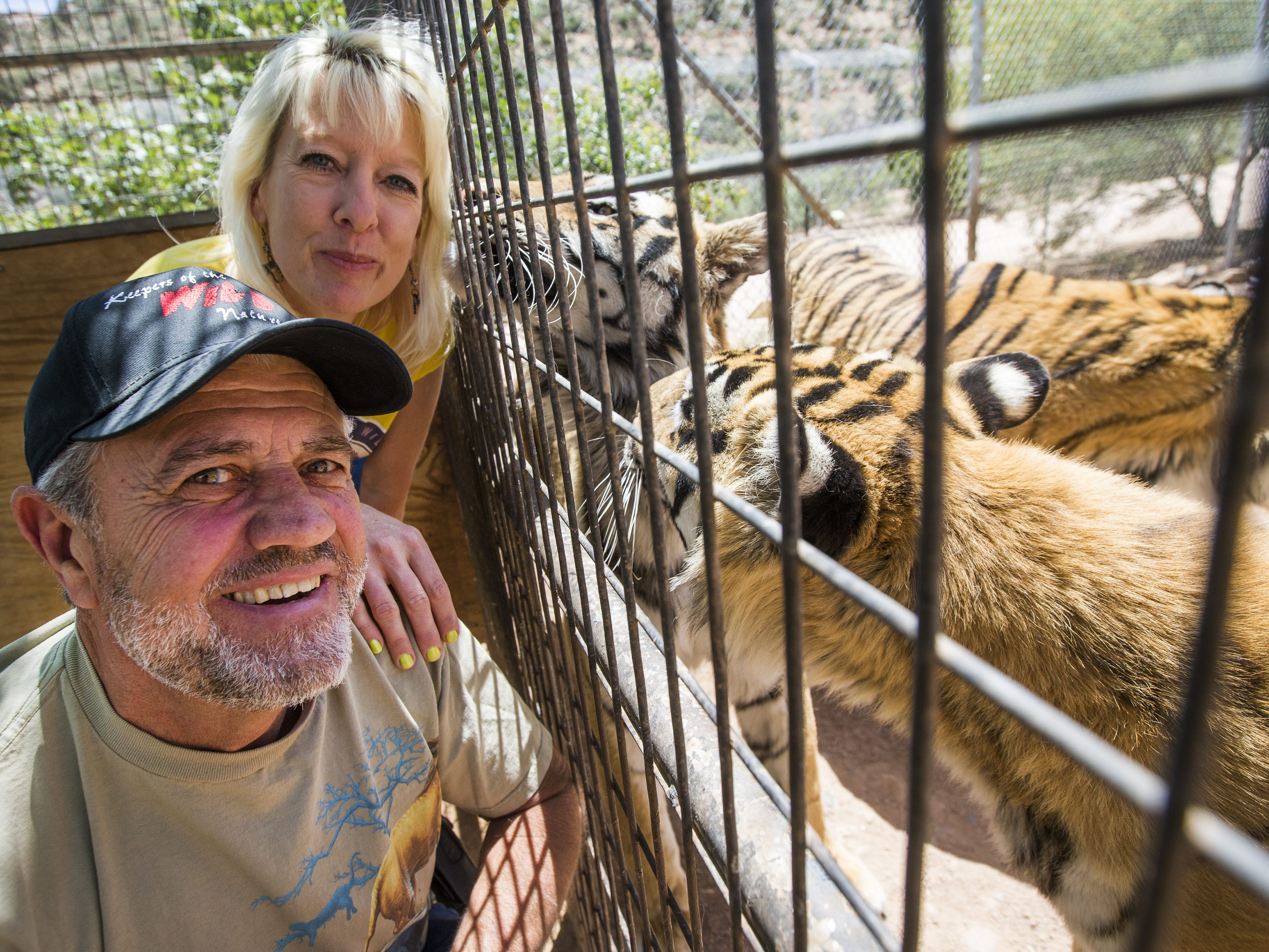 Keepers of the Wild founder Jonathan Kraft and co-director Tina Matejek pose near an enclosure for Bengal tigers, in Valentine, Ariz., on May 27, 2015. The nonprofit sanctuary for retired Las Vegas show tigers and other exotic animals is looking to expand north of Kingman.