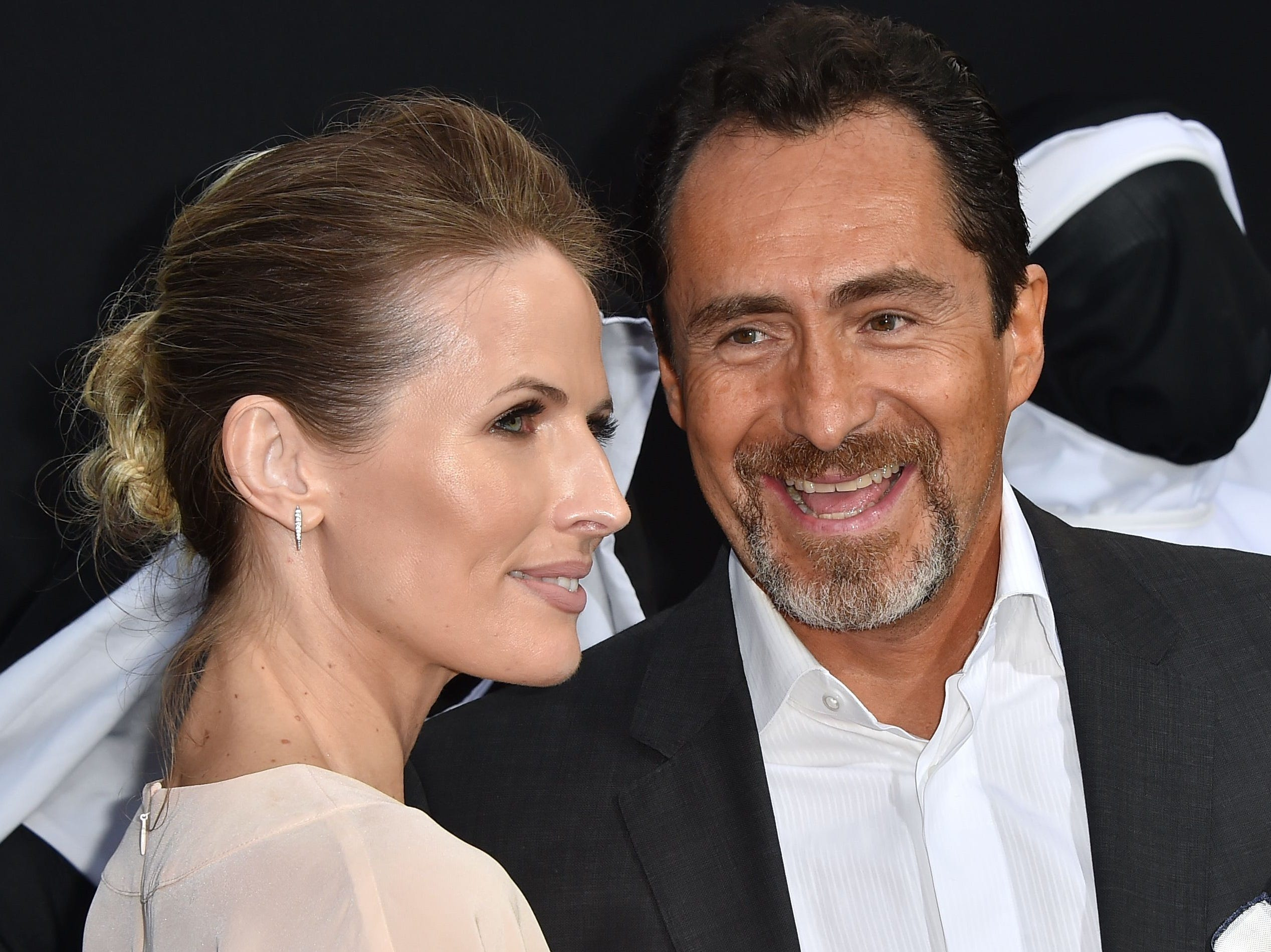 """Demian Bichir and his wife, Stefanie Sherk, attend the premiere of his film """"The Nun"""" in Hollywood, California, on Sept. 4, 2018."""