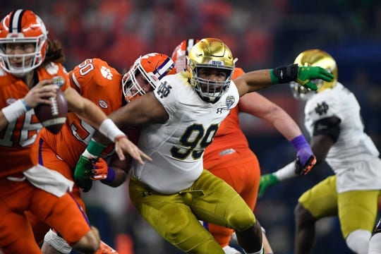 Notre Dame defensive lineman Jerry Tillery pressures Clemson quarterback Trevor Lawrence during a College Football Playoff semifinal game at AT&T Stadium Stadium.