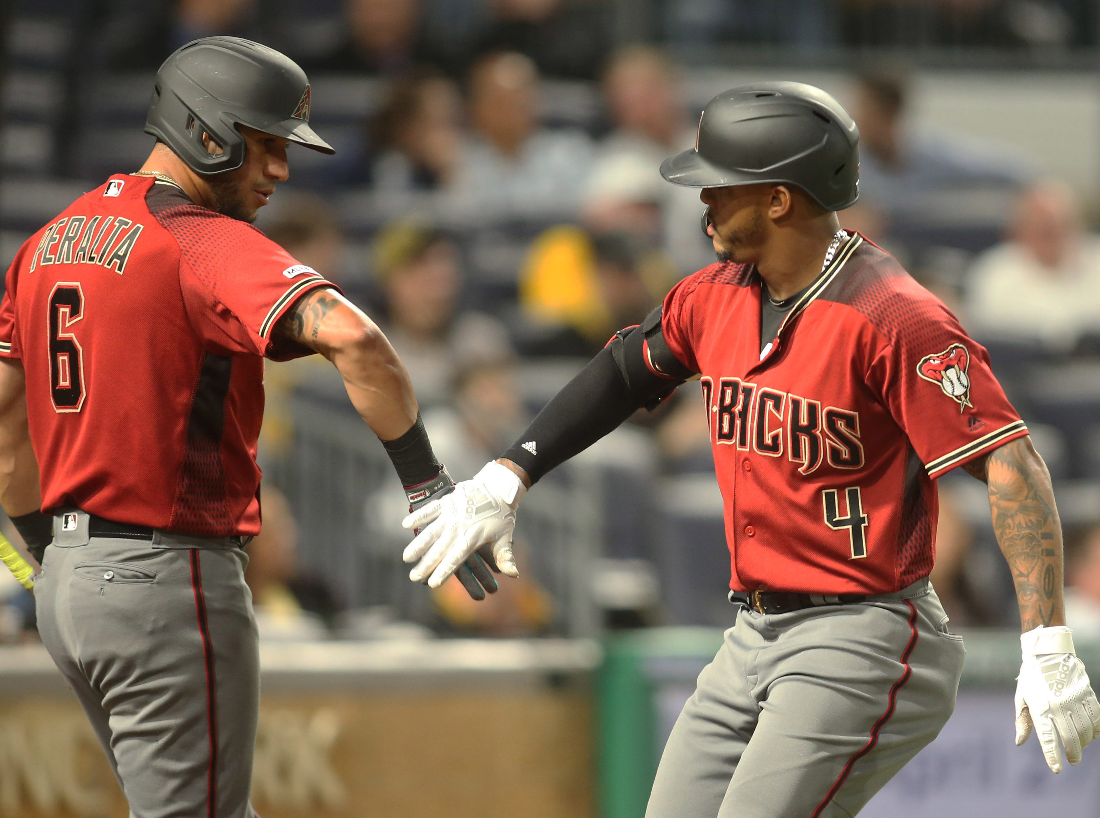 Apr 24, 2019; Pittsburgh, PA, USA;  Arizona Diamondbacks  center fielder Ketel Marte (4) celebrates with left fielder David Peralta (6) after hitting a solo home run against the Pittsburgh Pirates during the fifth inning at PNC Park. Mandatory Credit: Charles LeClaire-USA TODAY Sports