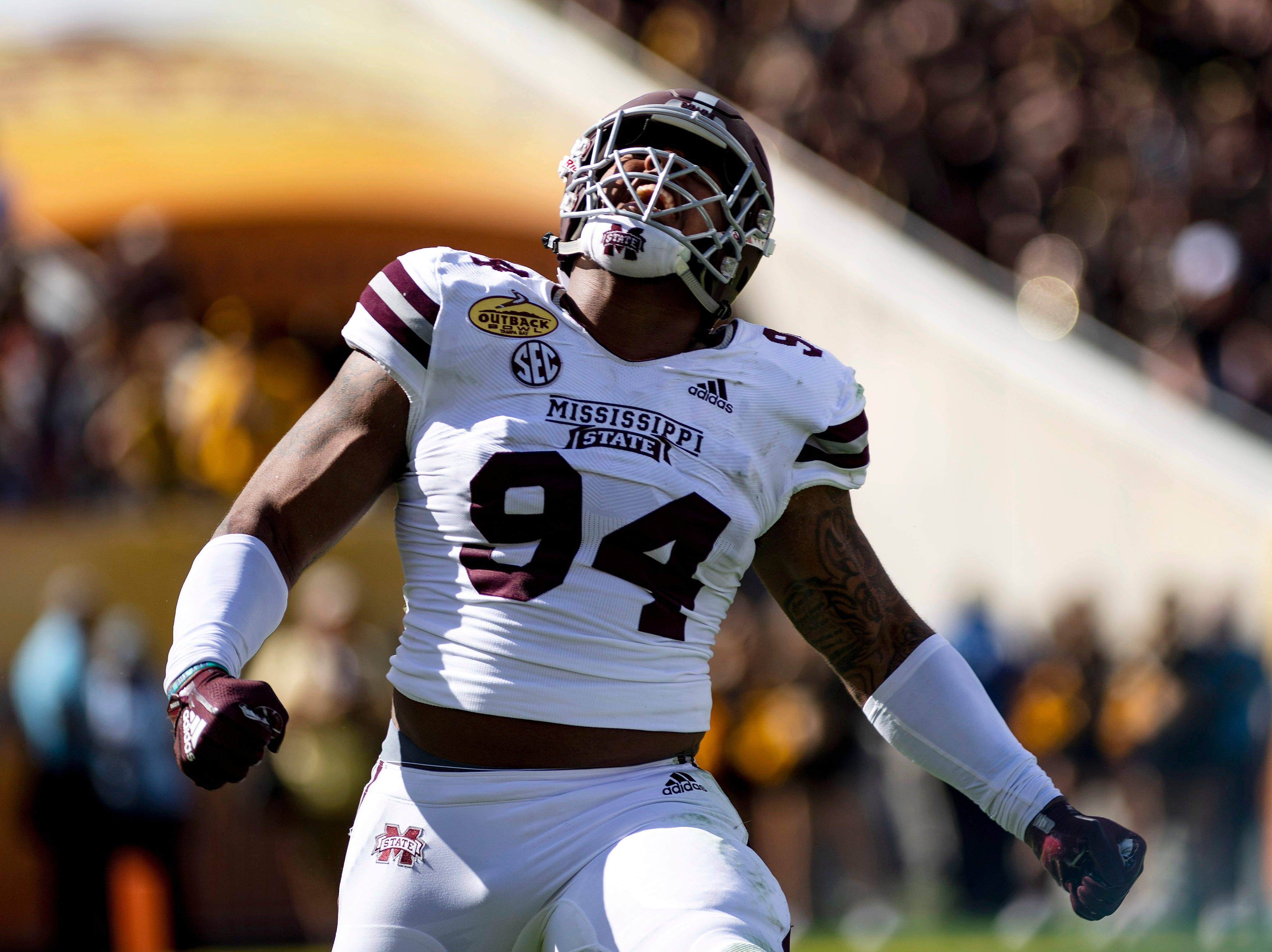Mississippi State defensive tackle Jeffery Simmons celebrates after getting a sack during a game against Iowa in the Outback Bowl at Raymond James Stadium.