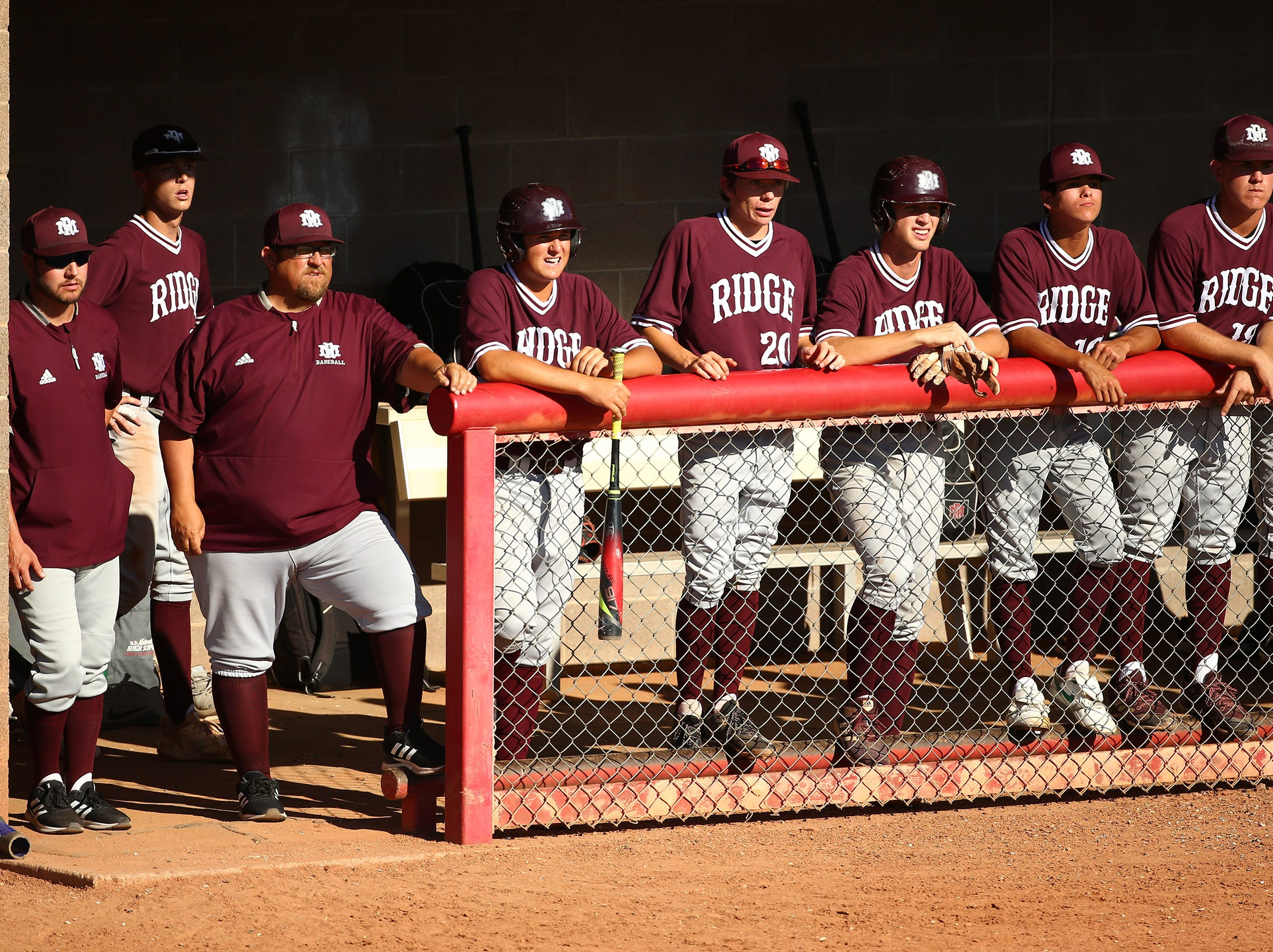 Mountain Ridge coach Artie Cox (third to the left) against Brophy Prep in the third inning on Apr. 24, 2019 in Phoenix, Ariz