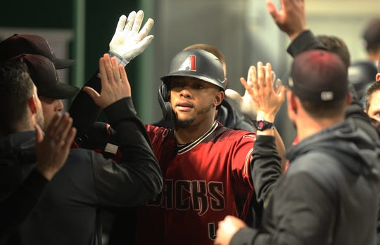 Ketel Marte celebrates one of his two homers with teammates on Wednesday.